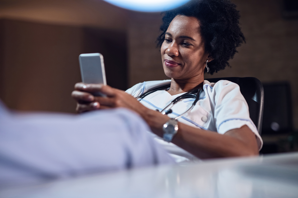 Healthcare employee using an employee engagement app from TheAppBuilder
